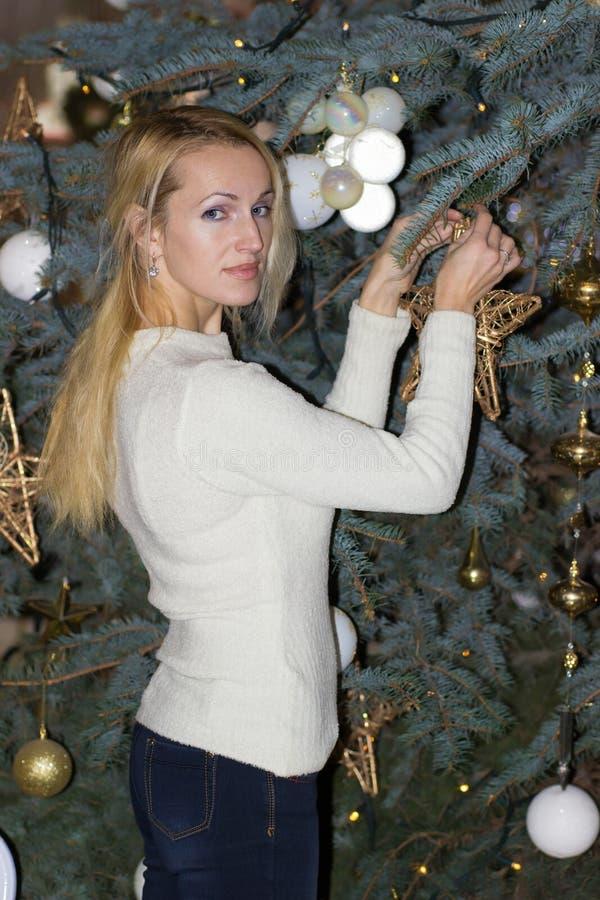 Smiling long hair woman celebration Christmas. Smiling blonde long hair woman celebration Christmas royalty free stock photography