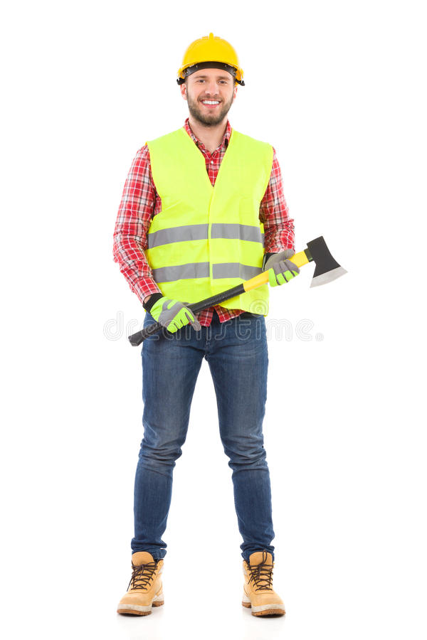 Smiling lumberjack with an axe. Happy man in lumberjack shirt, yellow helmet and lime reflective waistcoat posing with an axe. Full length studio shot isolated royalty free stock photography