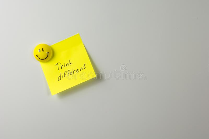 smiling magnet on a white fridge close-up stock images