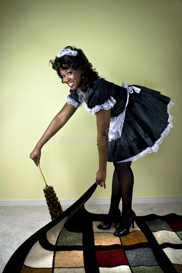 Smiling maid stock photography
