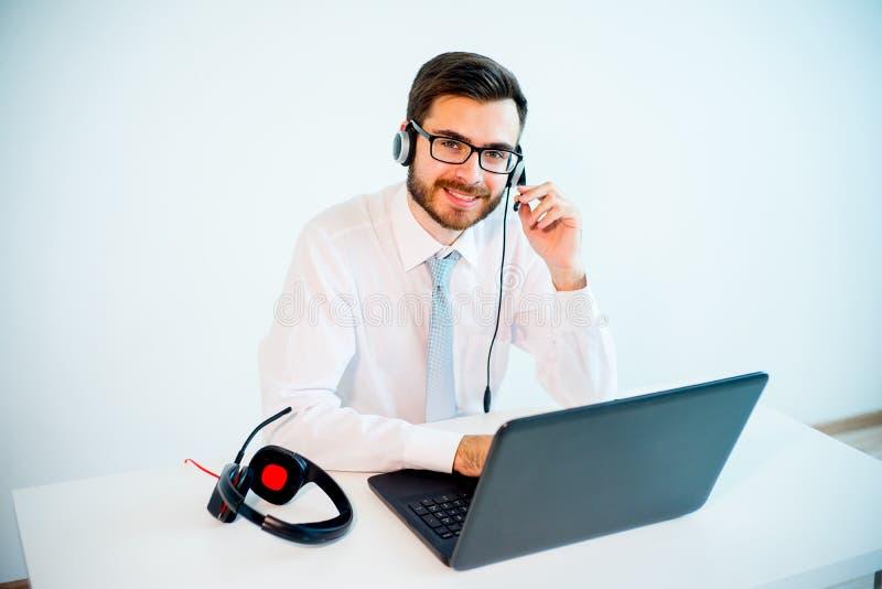 Smiling male call center operator stock photos
