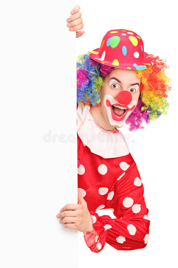 A Smiling Male Clown Posing Behind A Panel Stock Photos