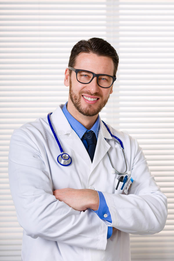 Smiling male doctor with glasses portrait stock photography
