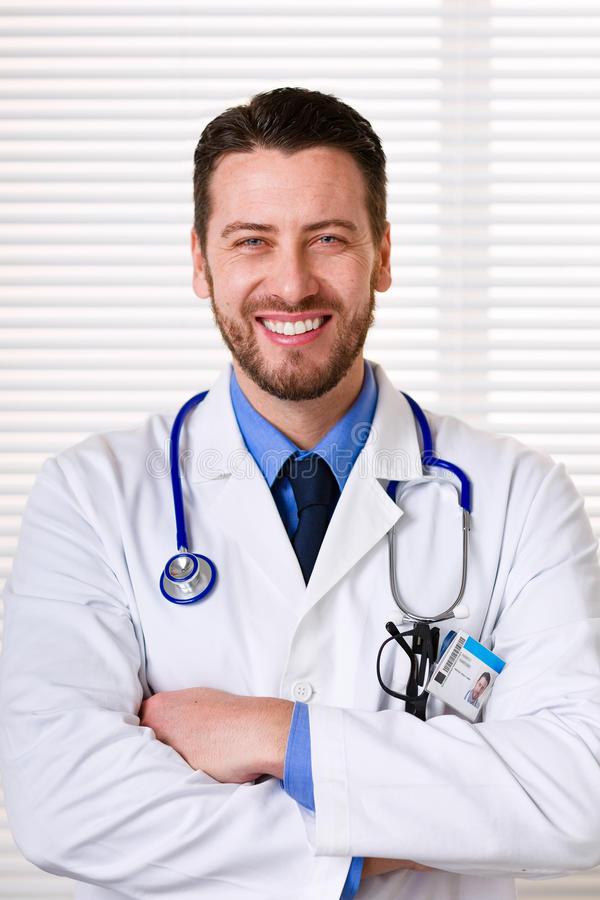 Smiling male doctor portrait royalty free stock photography