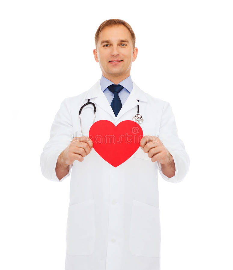 Smiling male doctor with red heart stock images