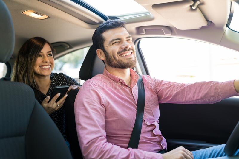 Happy Woman Talking With Driver In Car stock photo