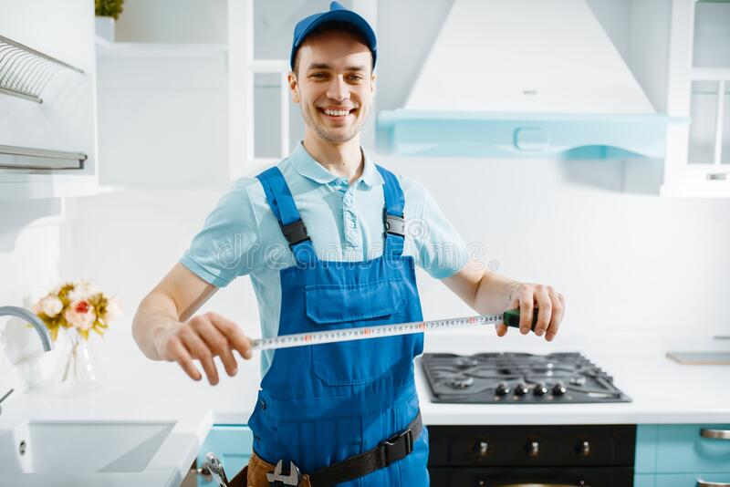 Male furniture maker holds measuring tape stock photos