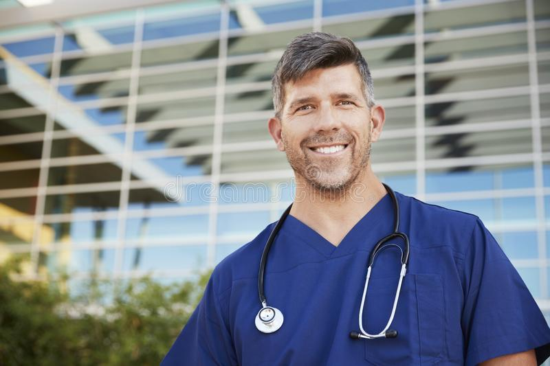 Smiling male healthcare worker outside hospital, portrait stock photos