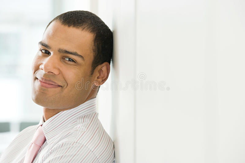 Smiling male office worker royalty free stock image