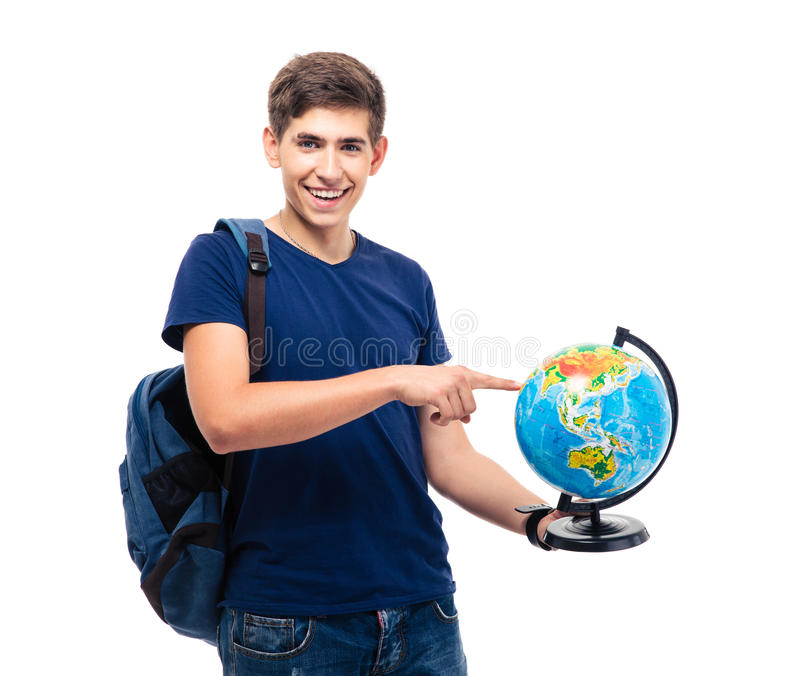 Smiling male student pointing finger on globe. And looking at camera isolated on a white background royalty free stock image