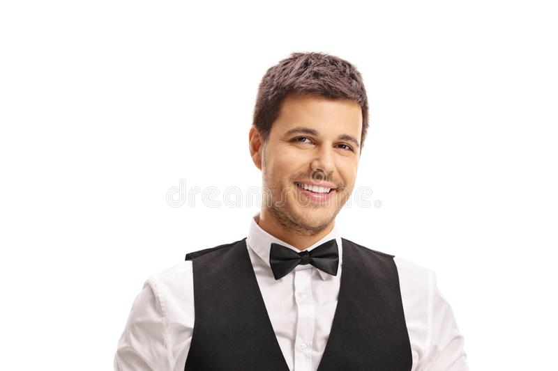 Smiling male waiter looking at the camera and smiling stock photo