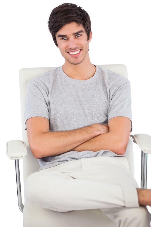 Download Smiling Man With Arms Crossed Sitting On A Swivel Chair Stock Image - Image: 32512059