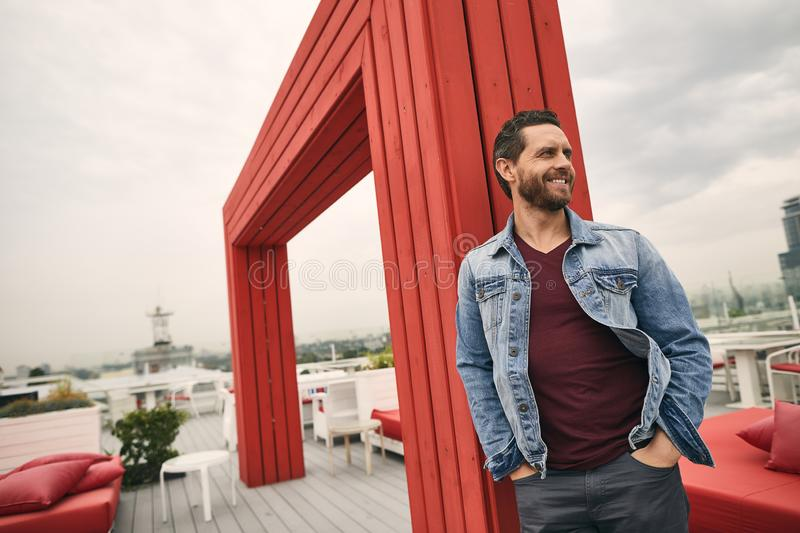 Happy guy is spending time on terrace royalty free stock image