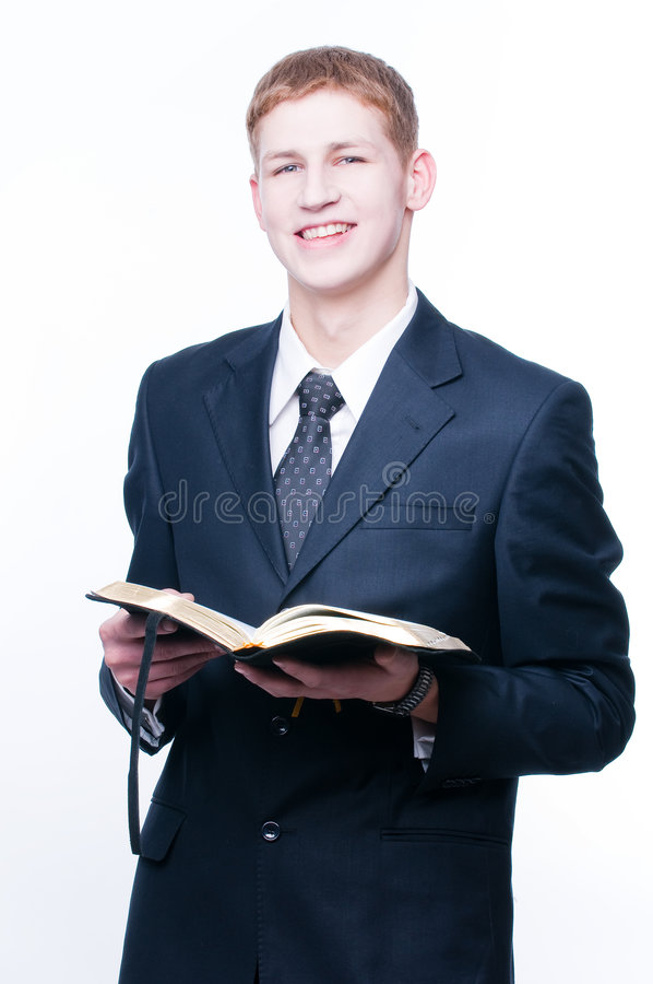 Smiling man with Bible. Isolated on white background royalty free stock photos