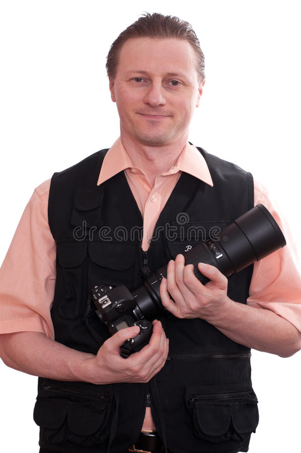 Smiling Man With A Camera And Huge Lens Royalty Free Stock Photos