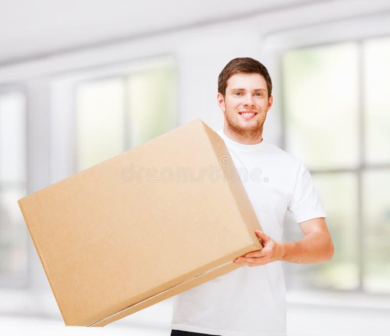 Download Smiling Man Carrying Carton Box Stock Image - Image: 37966405