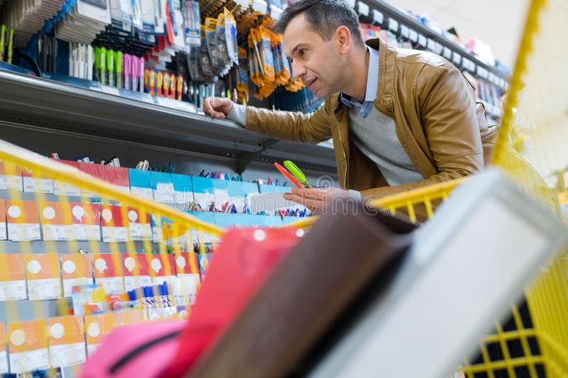 Smiling man driving shopping cart royalty free stock image