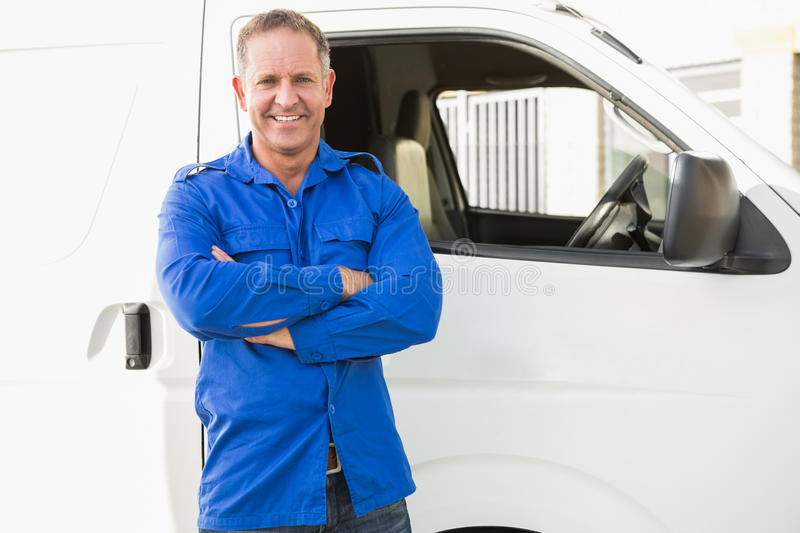 Smiling man in front of delivery van stock image