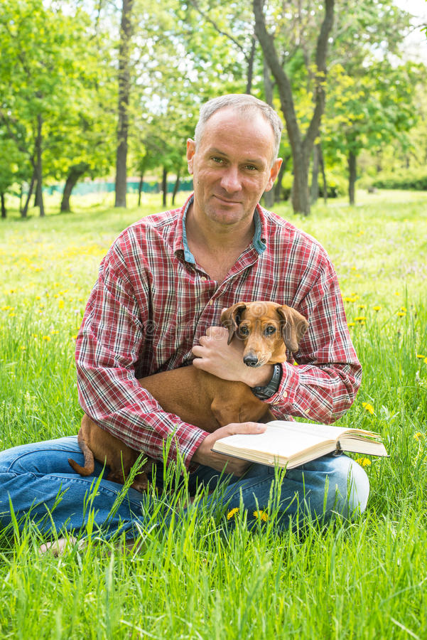 Smiling man with funny dog. royalty free stock photo