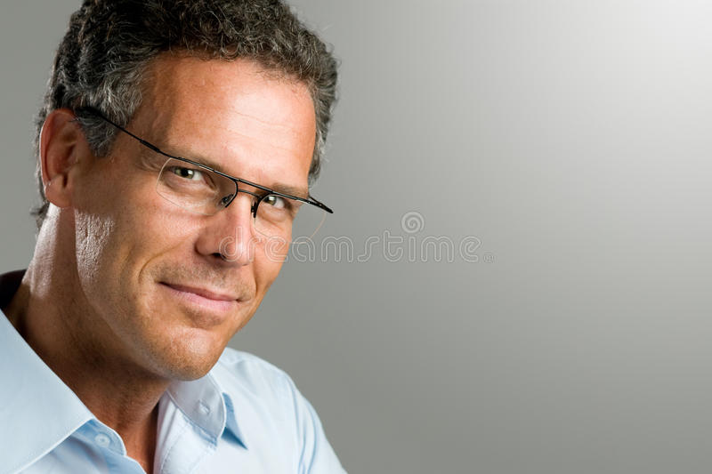 Smiling man with glasses stock photos