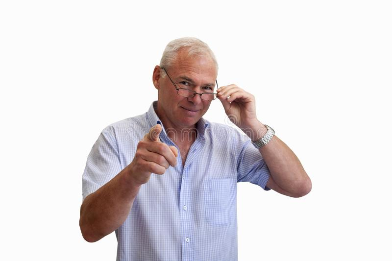 Smiling man with glasses pointing his finger royalty free stock photo