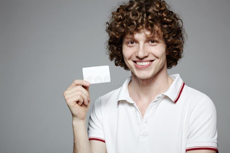 Smiling Man Holding Blank Credit Card Stock Image