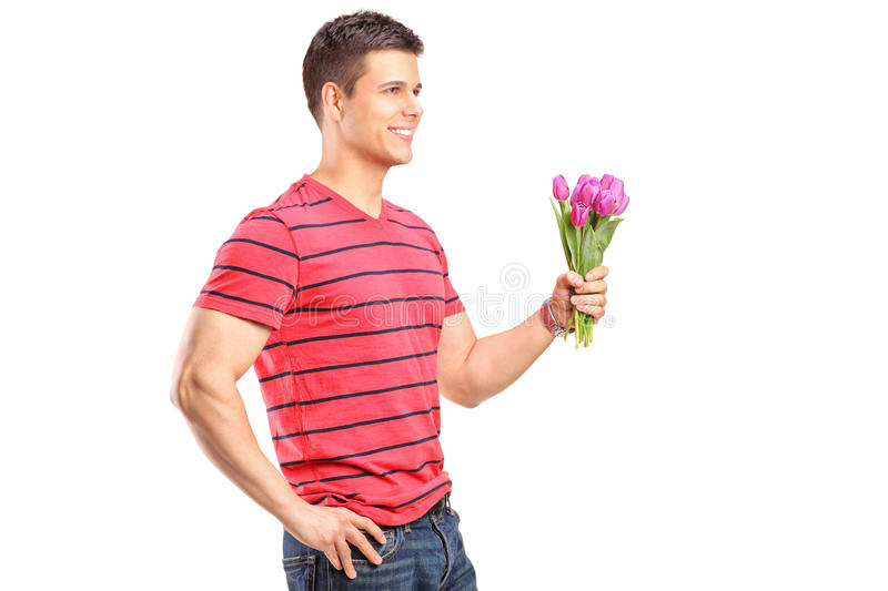 Download A Smiling Man Holding A Bunch Of Flowers Stock Photo - Image: 24285020