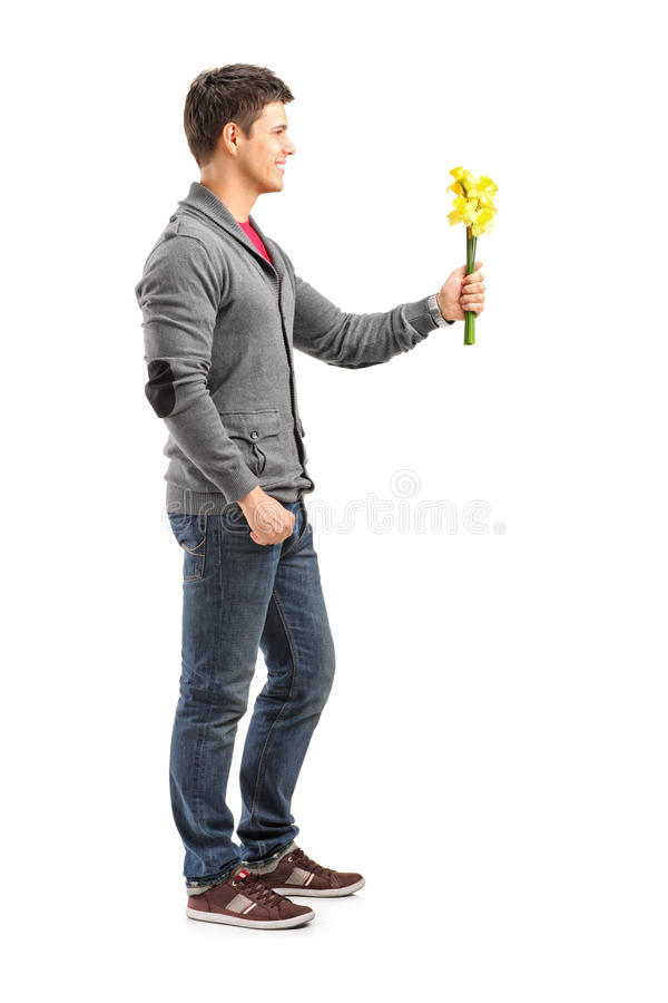 Smiling man holding a bunch of flowers stock image