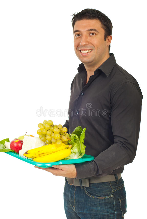 Smiling man holding healthy nutrition stock photo