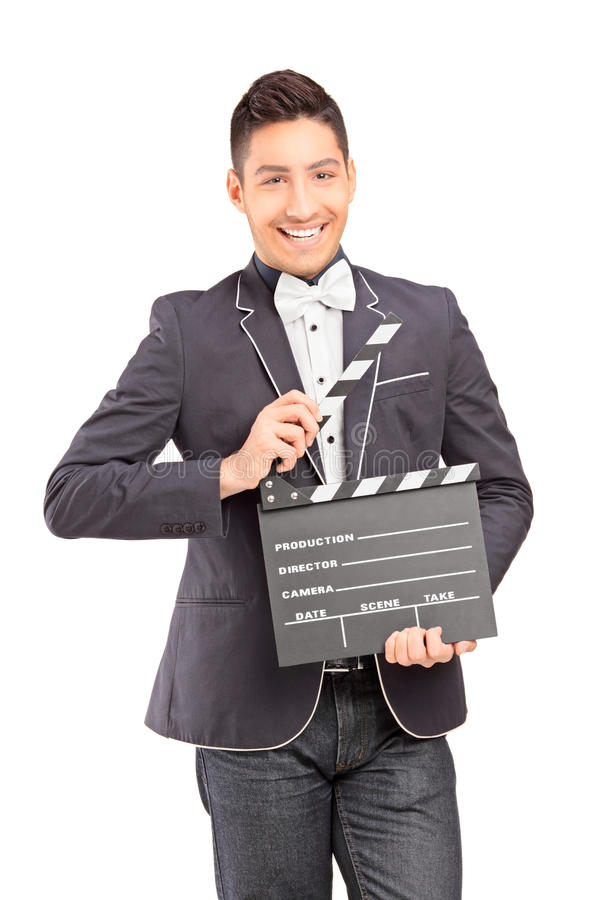 A smiling man holding a movie clap. Isolated on white background stock photography