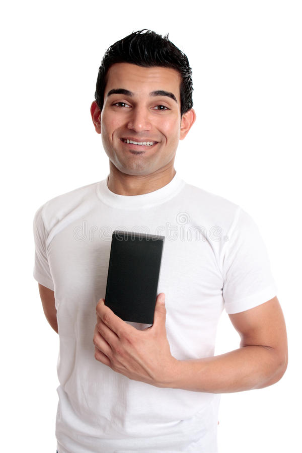 Smiling man holding retail product. A consumer or man holding a retail merchandise in a blank box ready for your design. He is dressed casually and smiling royalty free stock photography