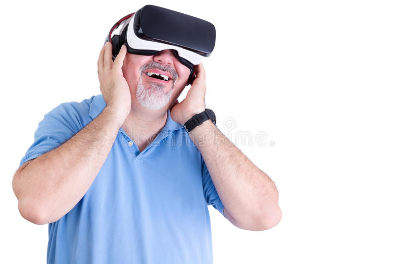 Smiling man holds virtual reality glasses to face stock photo