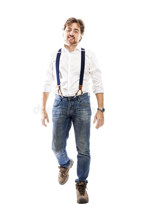 Smiling man in jeans and a white shirt. Full height. Isolated on a white background. stock image