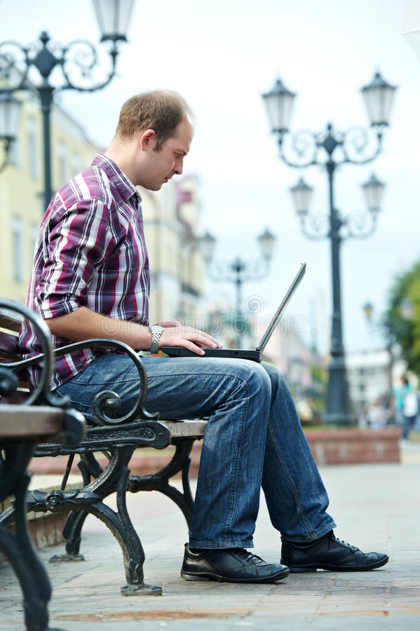 Download Smiling man with laptop stock photo. Image of modern - 27150316
