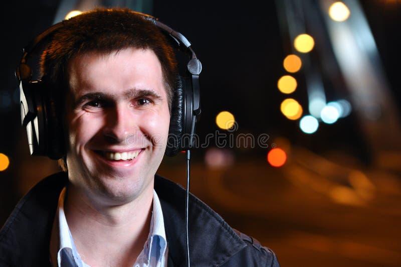 Download Smiling Man Is Listening Music Stock Image - Image: 16686327