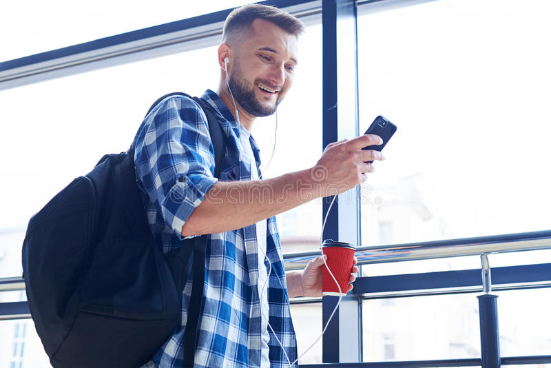 Smiling man looking at phone royalty free stock images