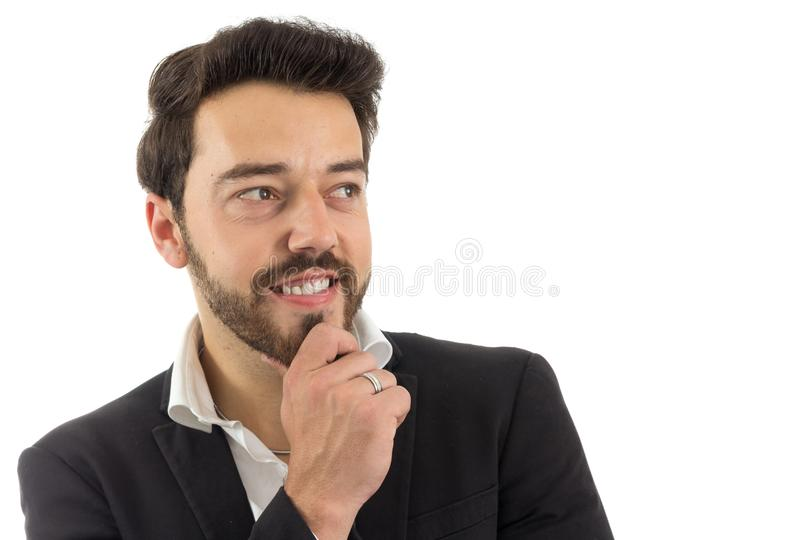 Smiling man looks to the side. bearded person wears black jacket stock photo