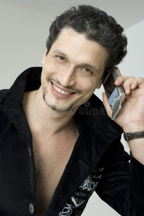 Download Smiling Man With Mobile Phone Stock Image - Image: 4713223