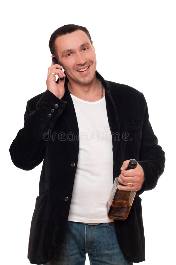 Smiling man with a phone and bottle of scotch