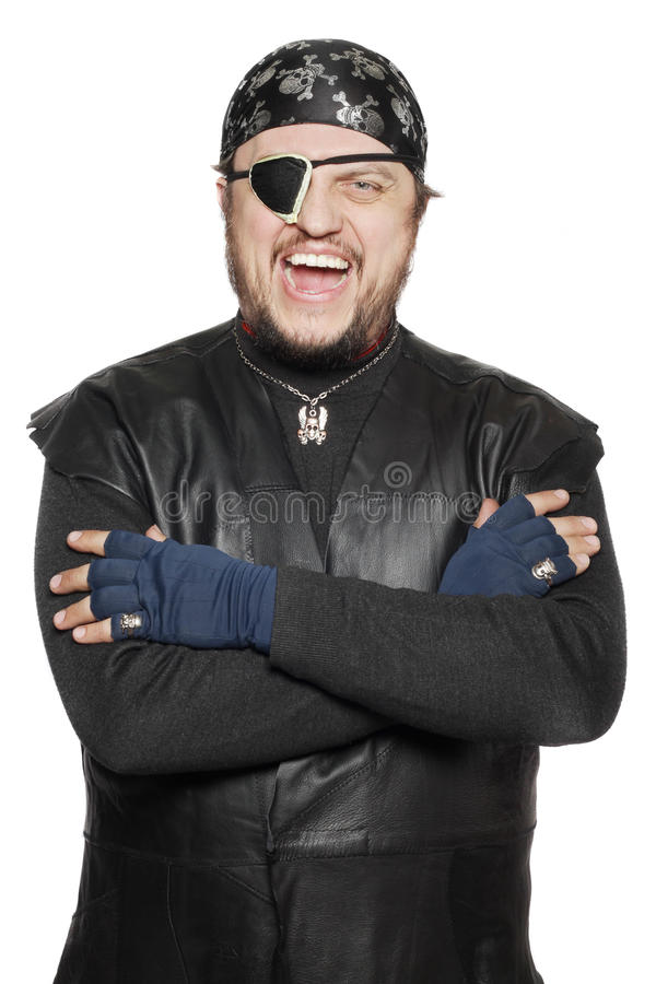 Smiling man in a pirate costume stock image