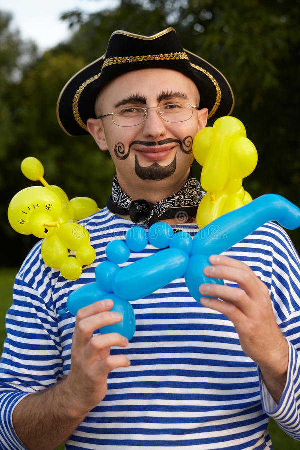 Smiling man in pirate suit with three air-ballons royalty free stock image