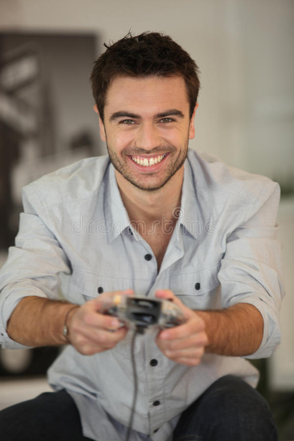 Smiling Man Playing Games Royalty Free Stock Image