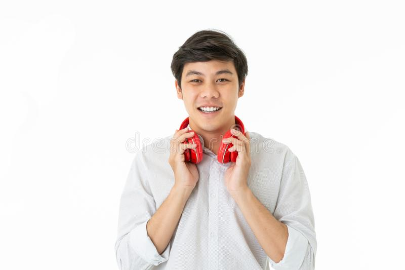 Smiling man with red headphone stock photo