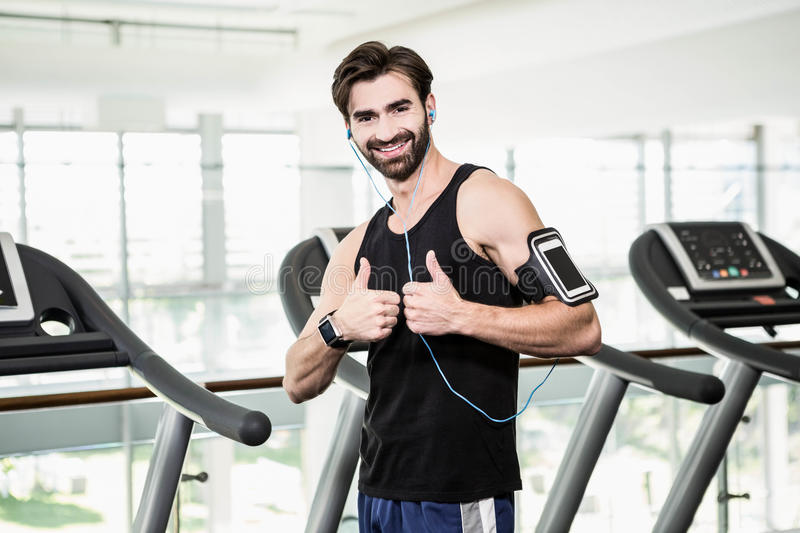 Smiling man showing thumbs up royalty free stock image