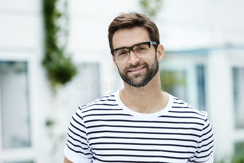 Smiling man in striped t-shirt stock photo