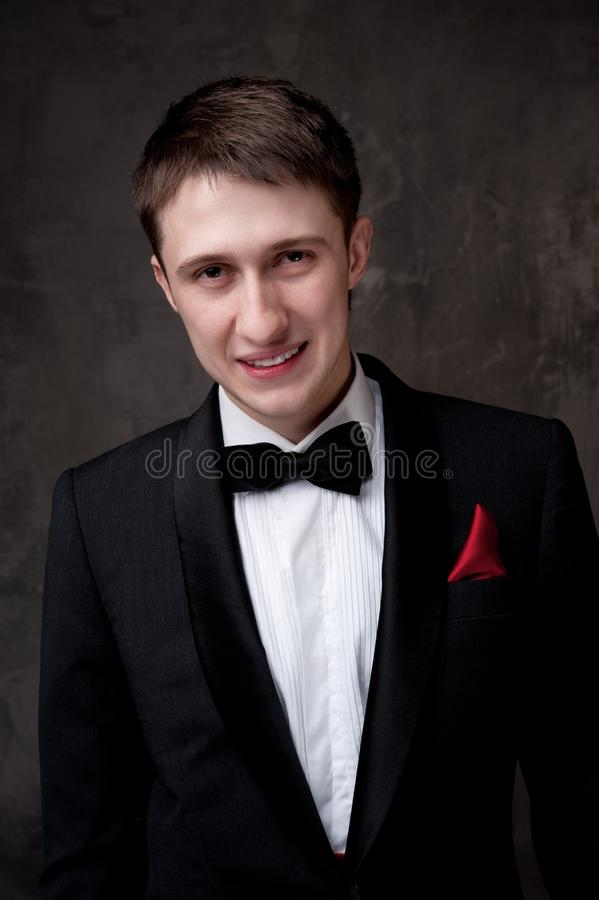 Download Smiling Man In Tuxedo On Grey Background Stock Photo - Image: 24453004