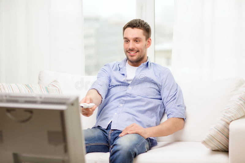 Download Smiling Man With Tv Remote Control At Home Stock Photo - Image: 40040502