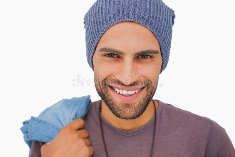 Smiling man wearing beanie hat. On white background royalty free stock photography