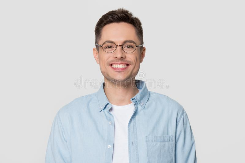 Smiling man wearing glasses looking at camera isolated on background stock images