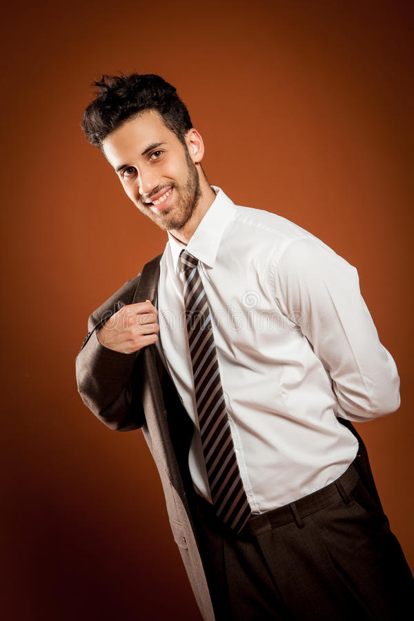 Smiling man wears a jacket royalty free stock images